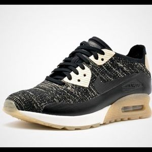 Nike Black and Gold Flyknit Air Max Sneakers